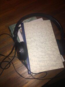 bøger og hovedtelefoner lydbøger
